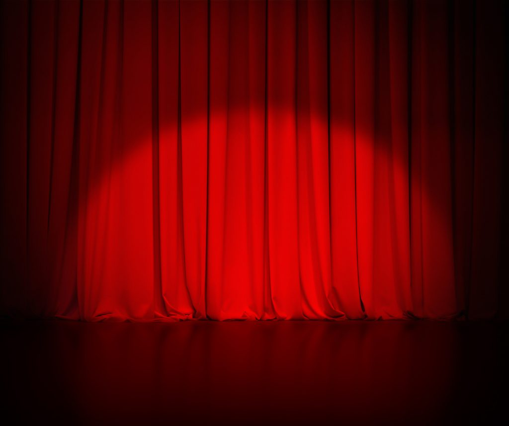 theatre red curtain awaiting the release of the 2018 Nissan Leaf