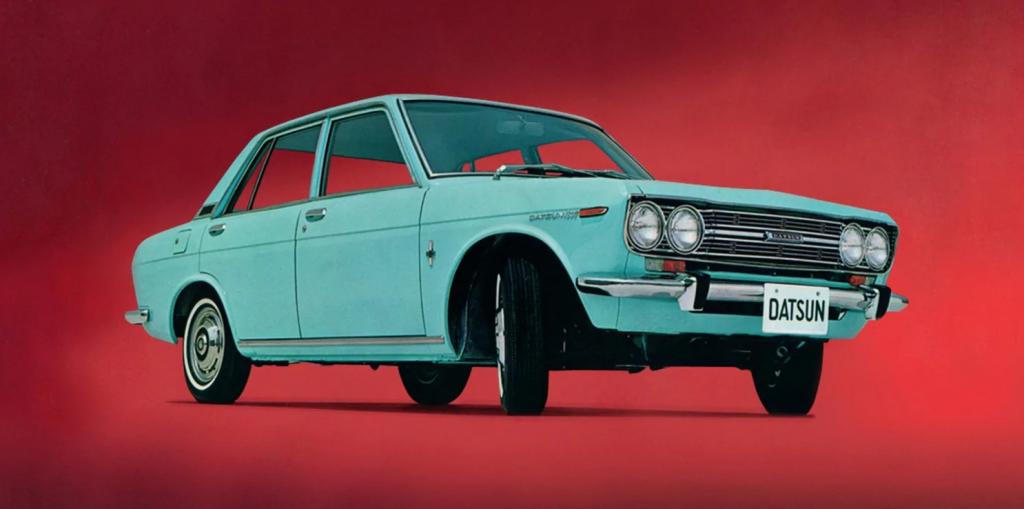 A teal 1970s Datsun/Nissan sedan